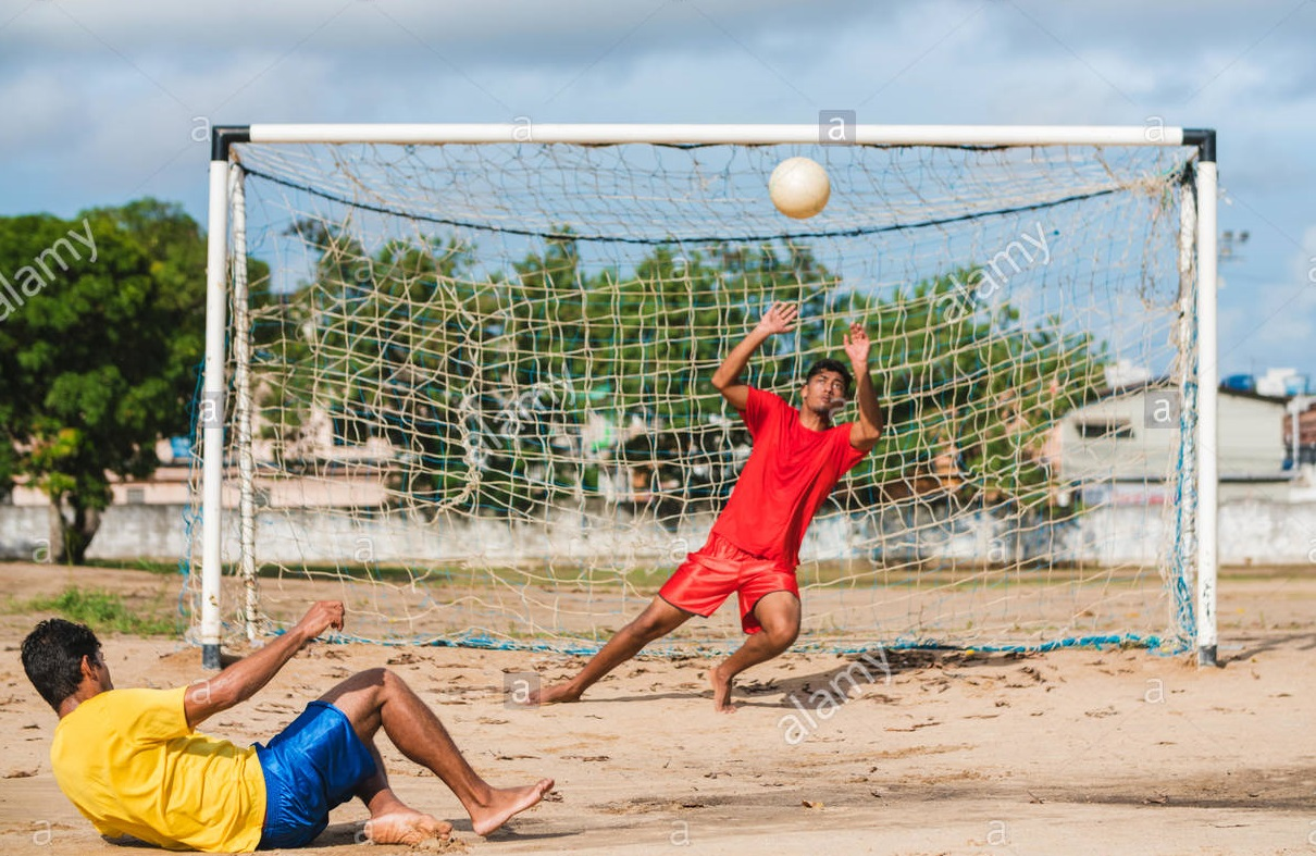 soccer-player-at-the-penalty-in-the-sand-field-in-northeastern-of-pernambuco-brazil-MANB1J