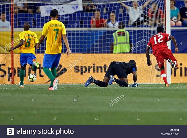 canada-midfielder-alphonso-davies-r-scores-a-goal-past-french-guiana-JGJXG4